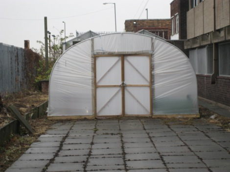 Polytunnel set on paving slabs
