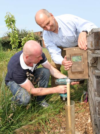 nurturing nature bee nest box on old pallet insect lodge in school grounds